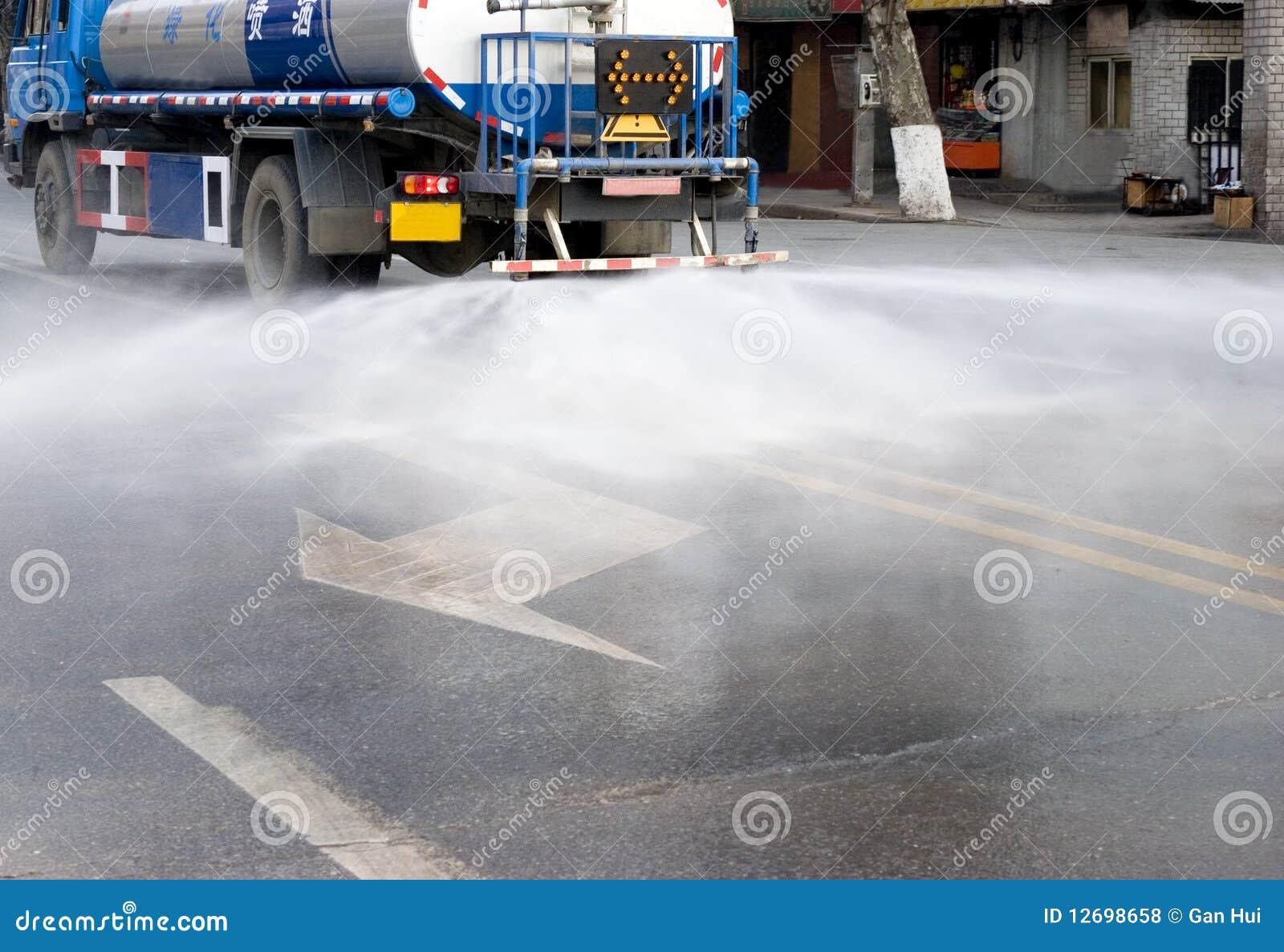 Water van watering the road