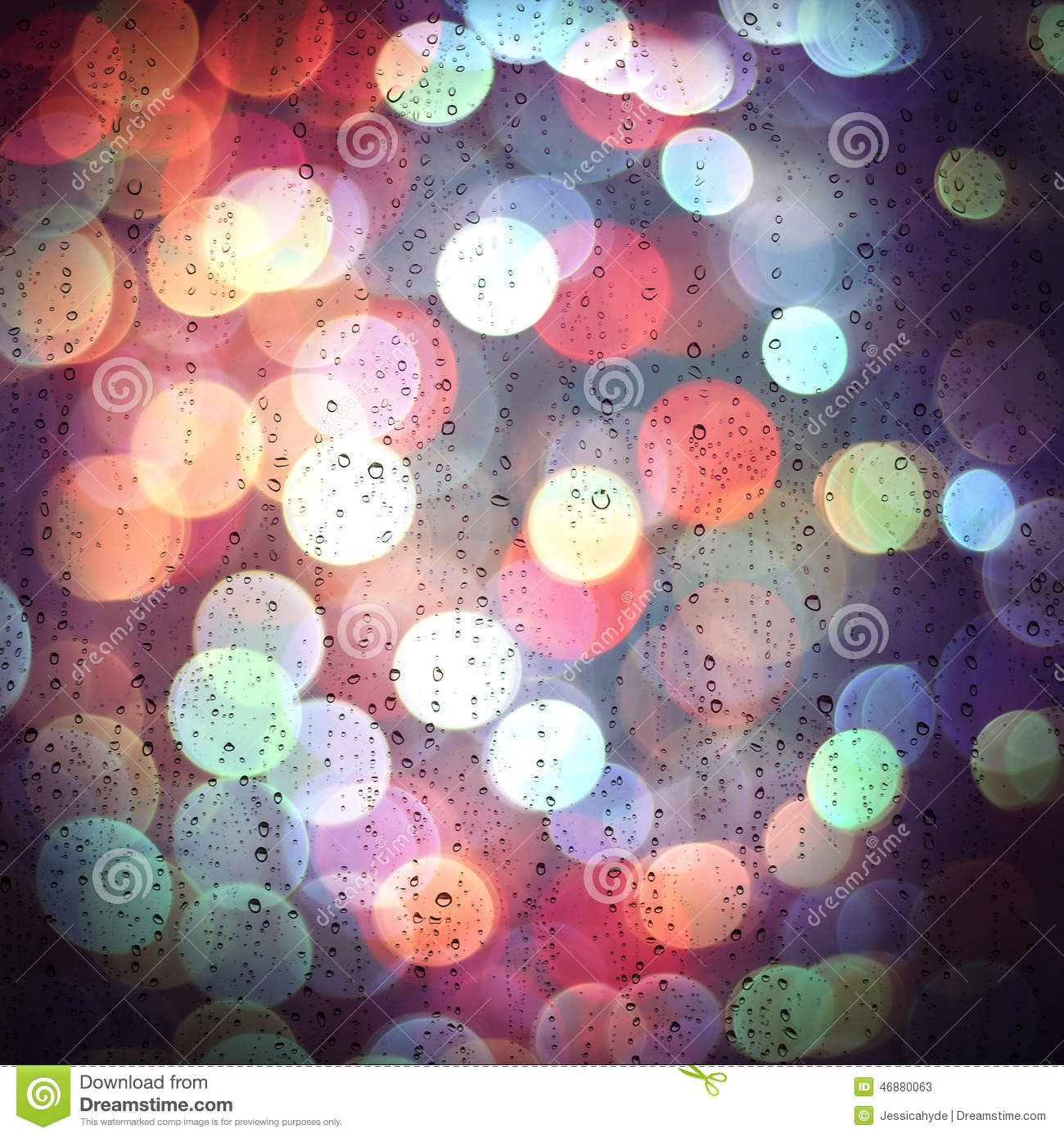 Waterdrops In A Glass And Colorful Bokeh Lights Stock Image
