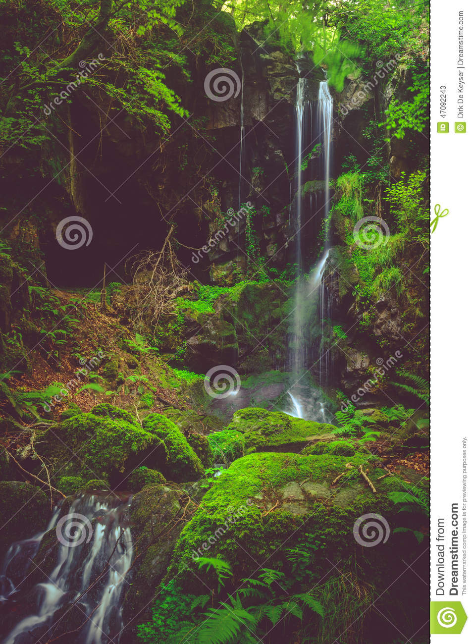 Waterfall and black cave , Auvergne, France