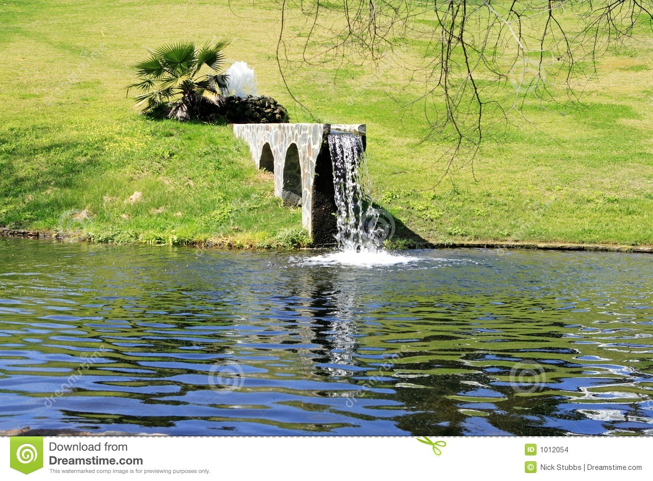 Waterfall From Man Made Bridge Into Lake Stock Images  Image: 1012054