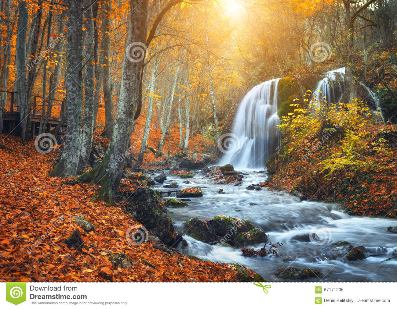waterfall at mountain river in autumn forest at sunset  stock image