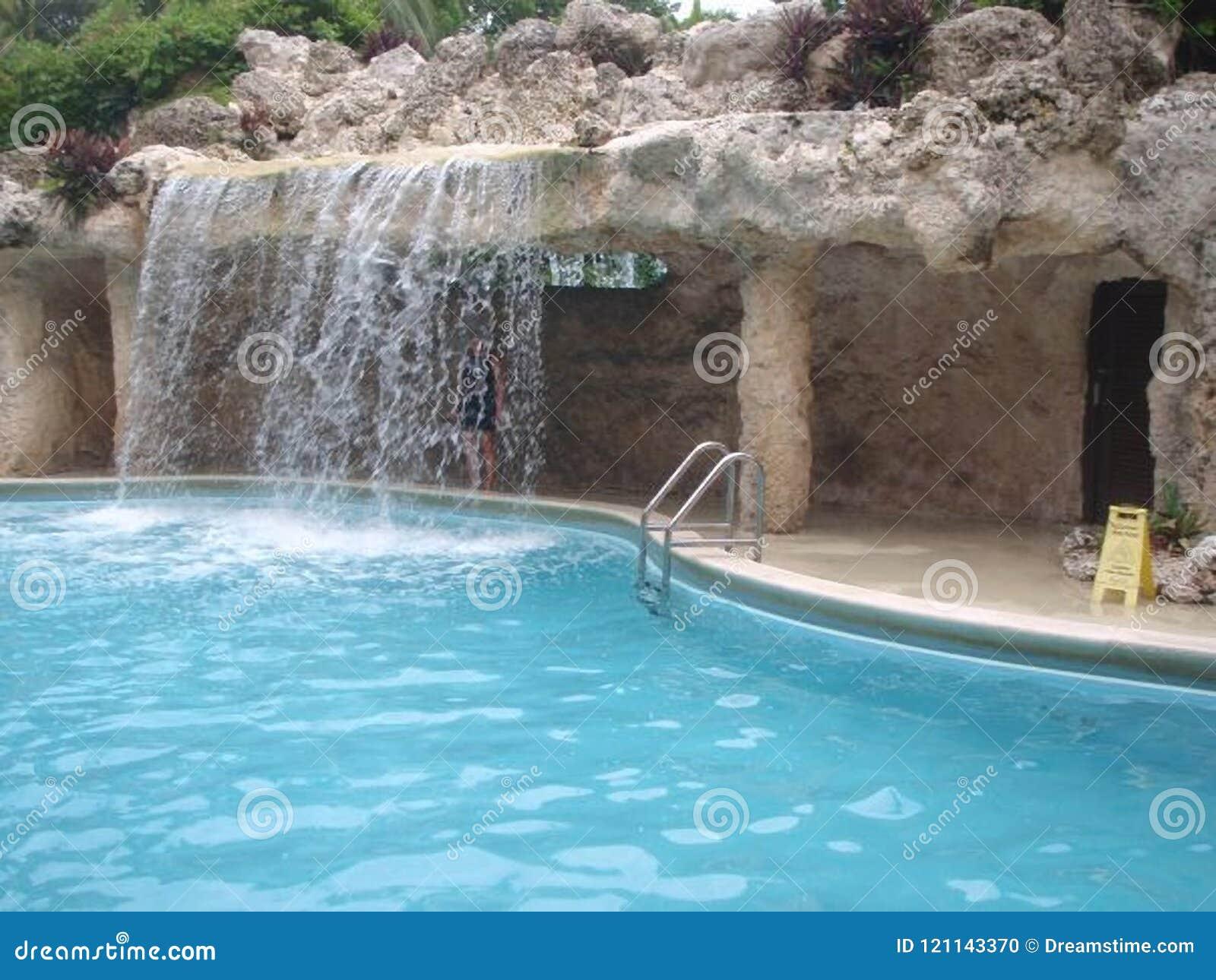 Waterfall At Resort Swimming Pool Stock Photo - Image of vacation ...