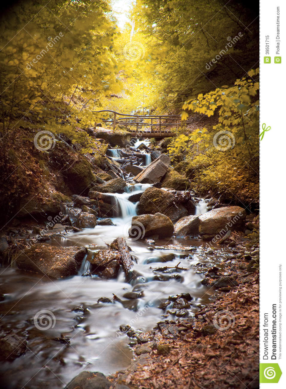 Waterfall with rocks in a autumn landscape