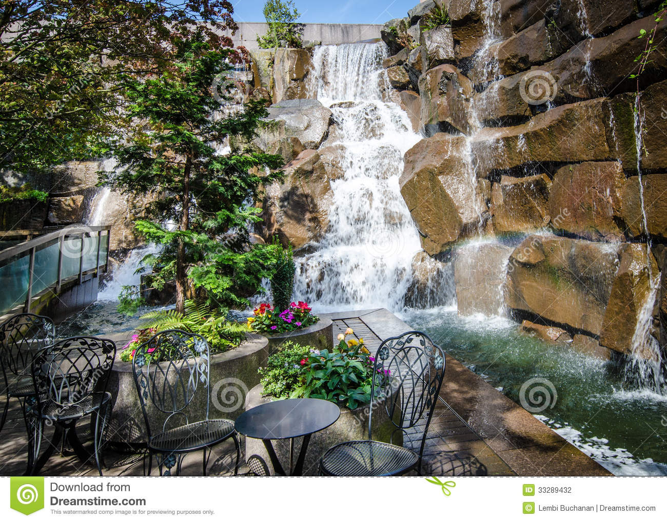 Waterfalls in a garden park on a summer day editorial for Bombas de agua para estanques de jardin