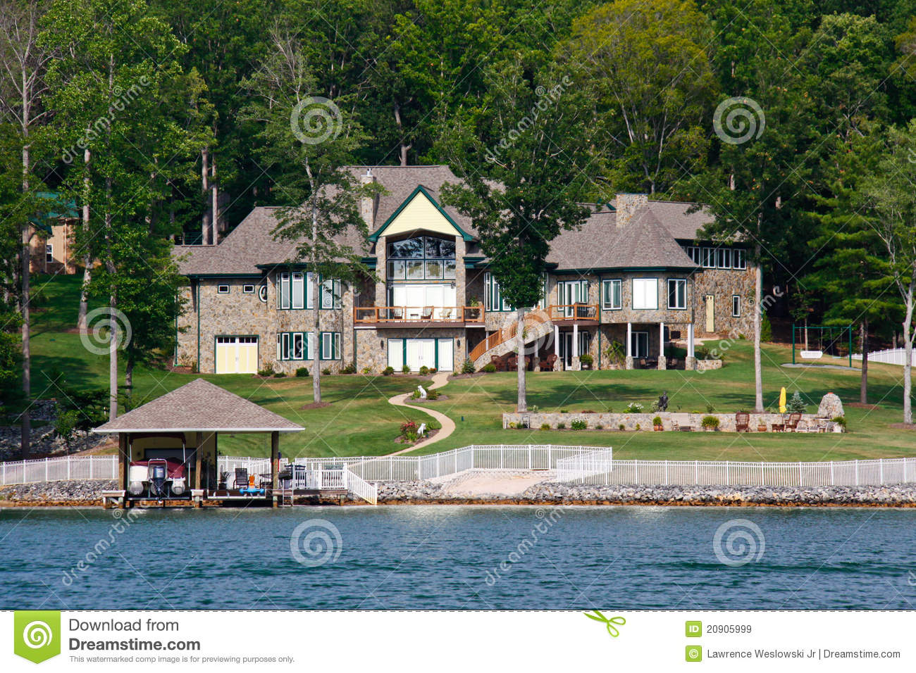 Waterfront Mansion With Pool Boat Jet Skis Stock Image