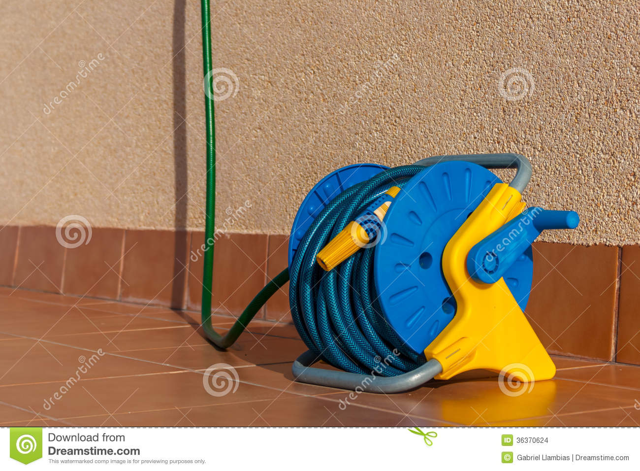 Watering garden hose stock photo. Image of coil, connector - 36370624