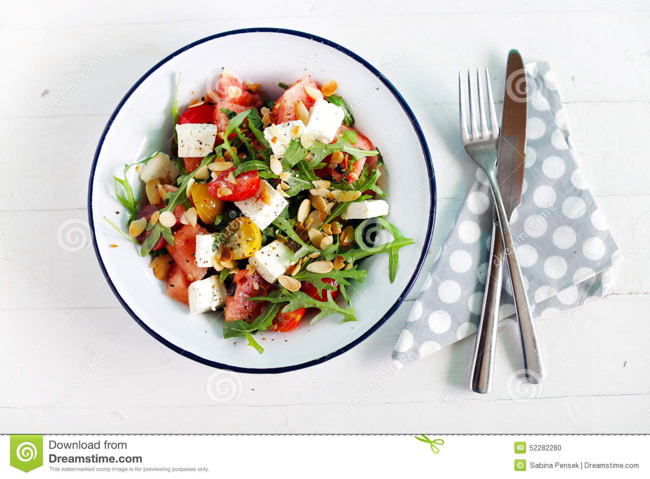 Watermelon salad with feta cheese and arugula, toasted almonds and ...