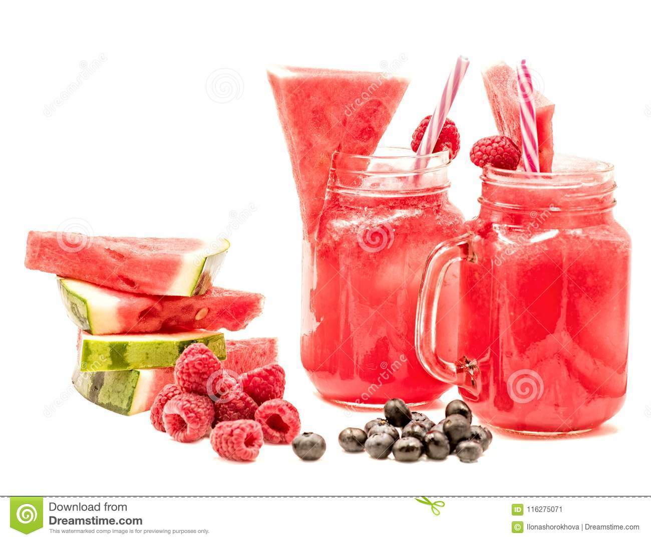 Watermelon smoothie in a mason jar decorated with a slice of watermelon, raspberries, blueberries and ice cubes isolated on white