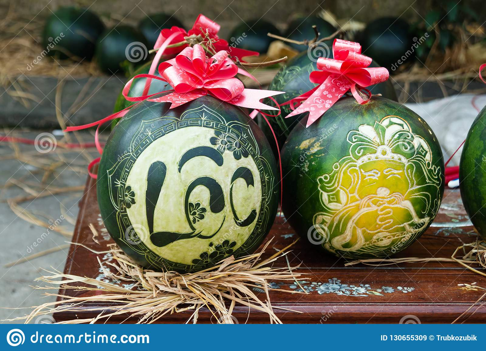 Watermelons with festive engraving on Eve of Vietnamese New Year. The inscription is translated - Clarify. Hue, Vietnam