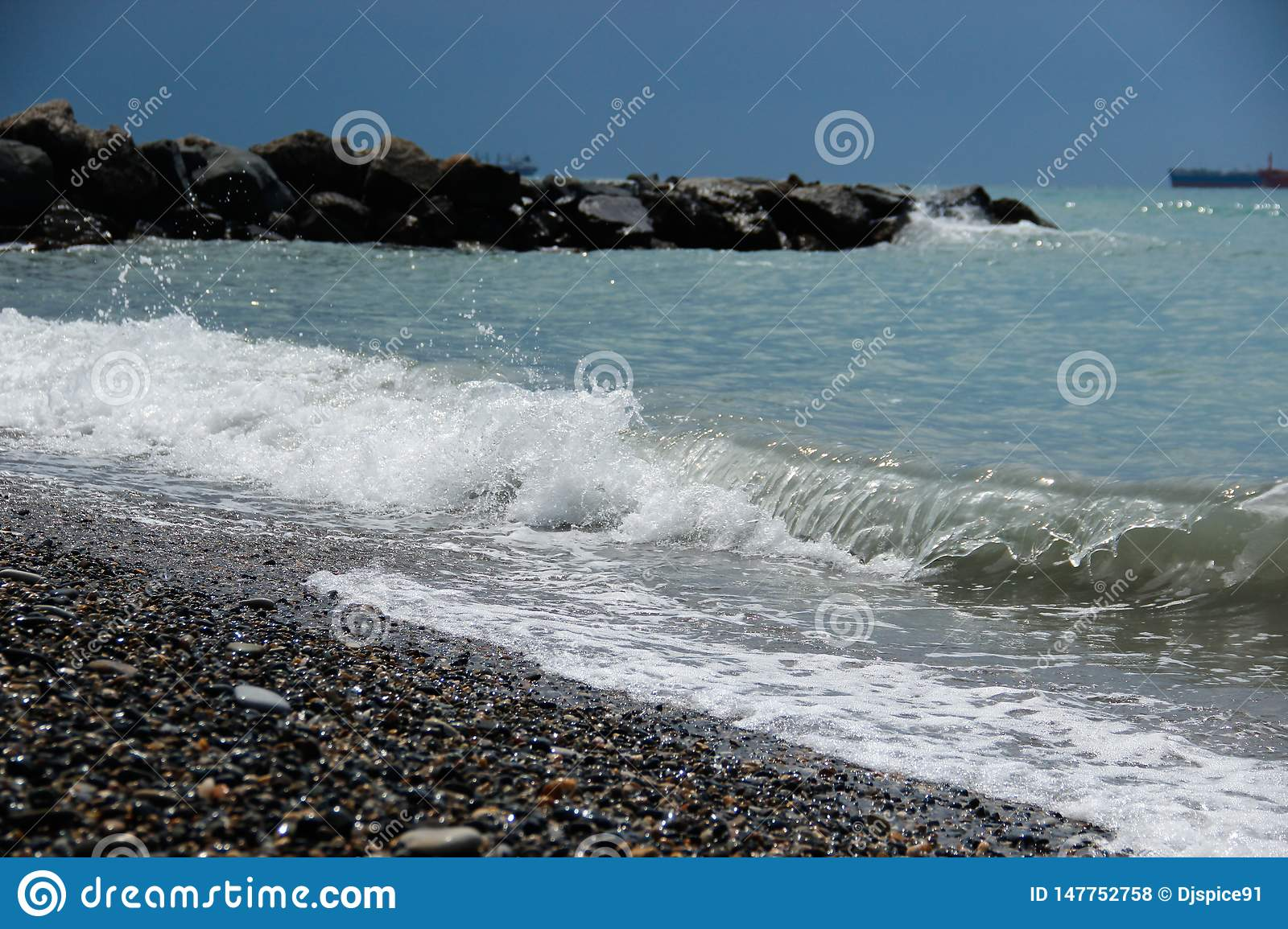 Wave at the rocky shore of the sea