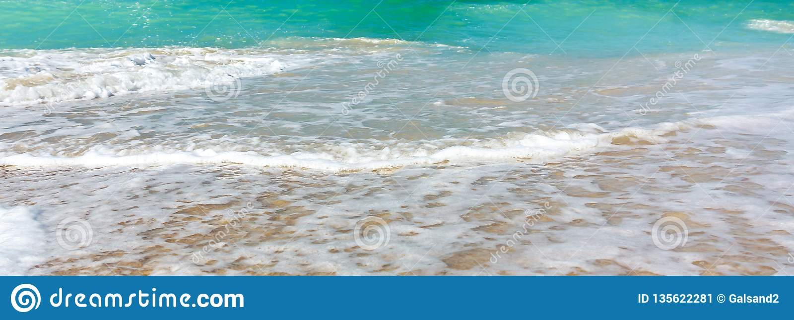 Wave surf on the sea coast, clean sea shore and turquoise water, horizontal panoramic image, background for banner