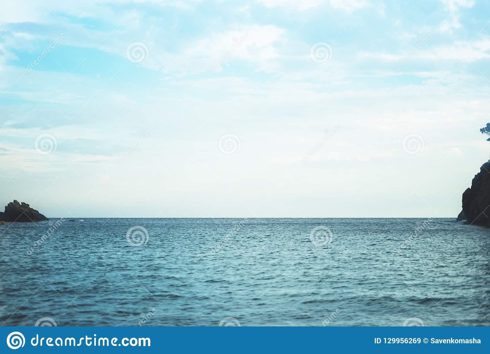 Waves of blue quiet ocean coast landscape. Background sea scape and sand beach coastline. Panorama horizon perspective view nature