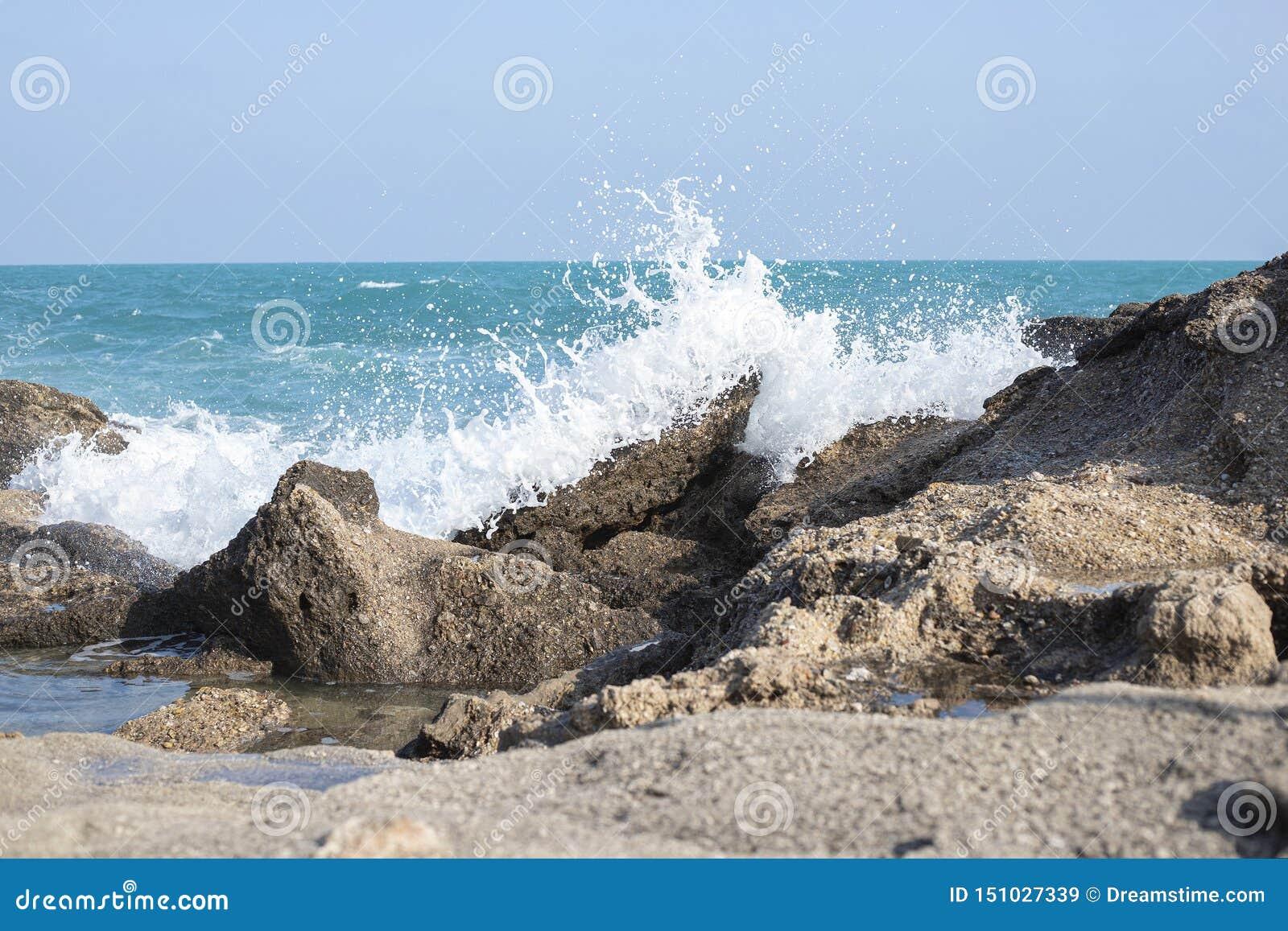 Waves blue sea stones storm nature background