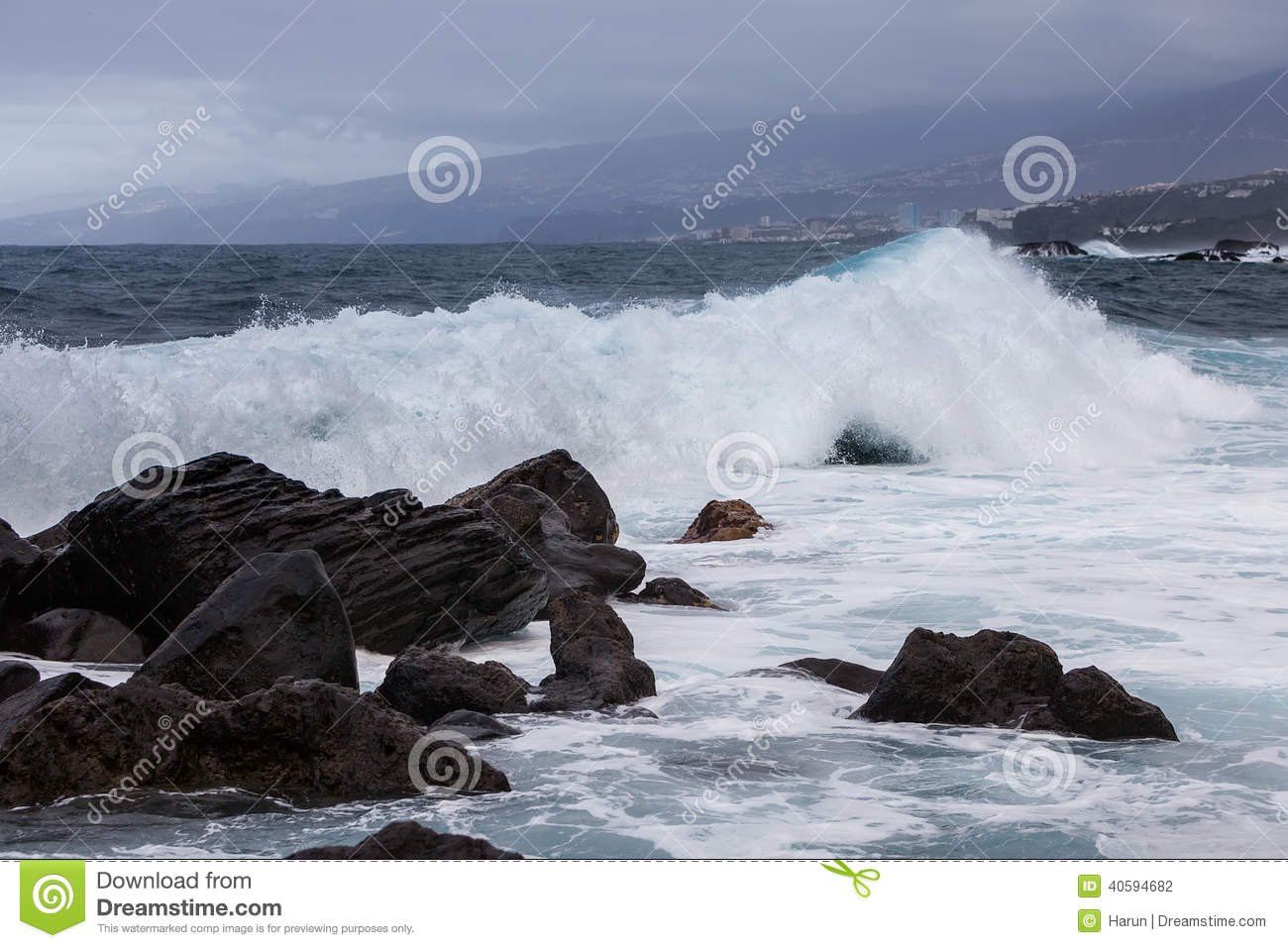 Scenic view or waves breaking over rocks on the coastline of Tenerife ...