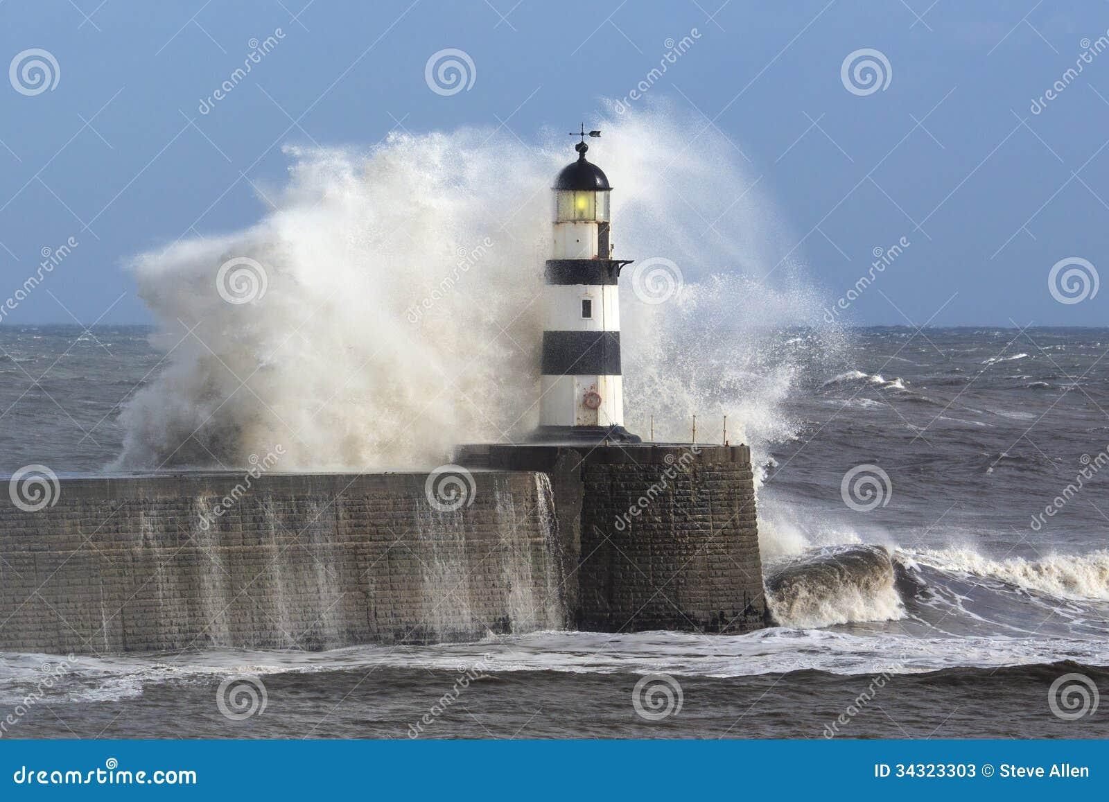 Waves Crashing Over Seaham Lighthouse Stock Photos Image