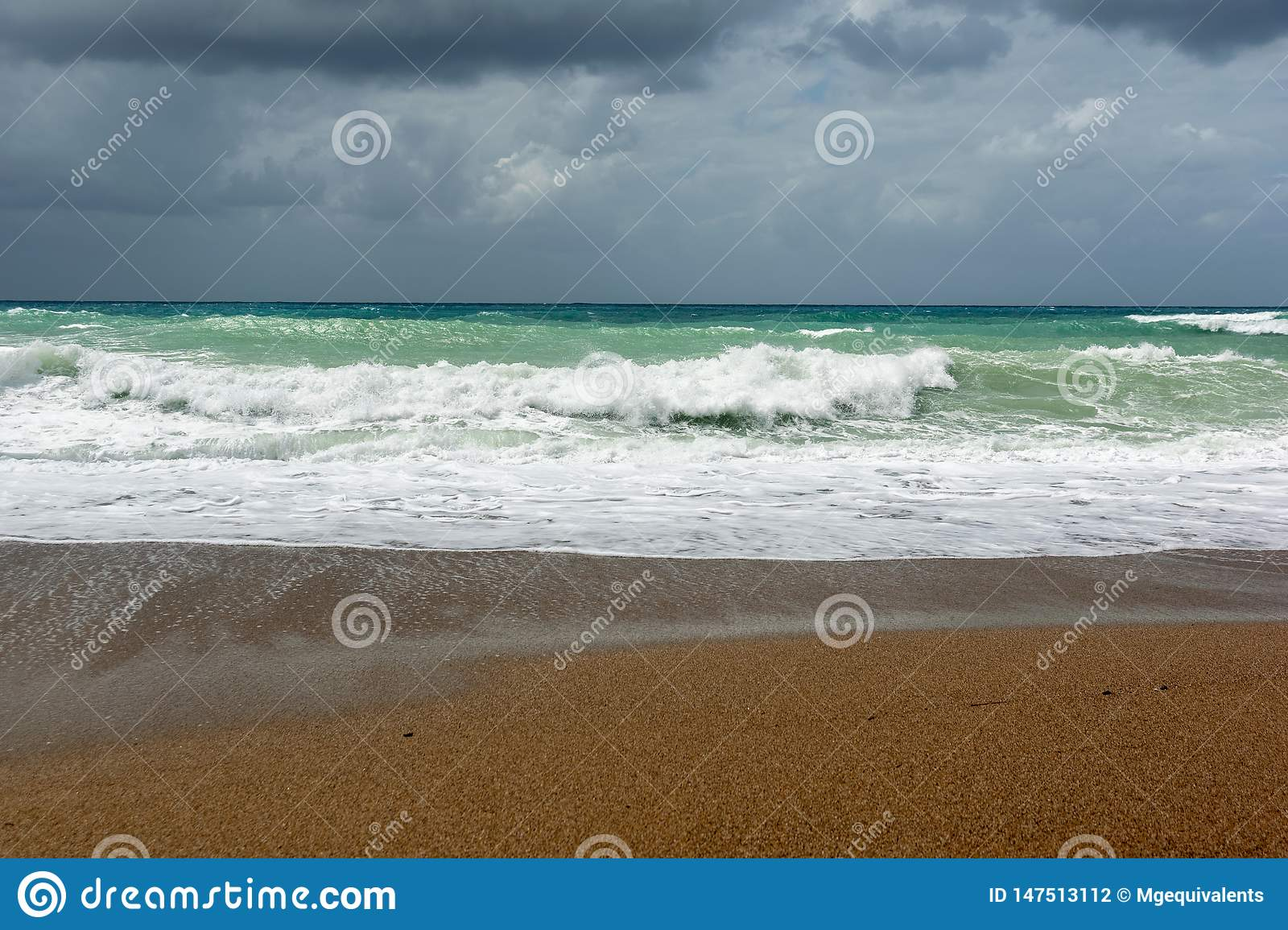 Waves On sand beach of the Aegean Sea in Rhodes