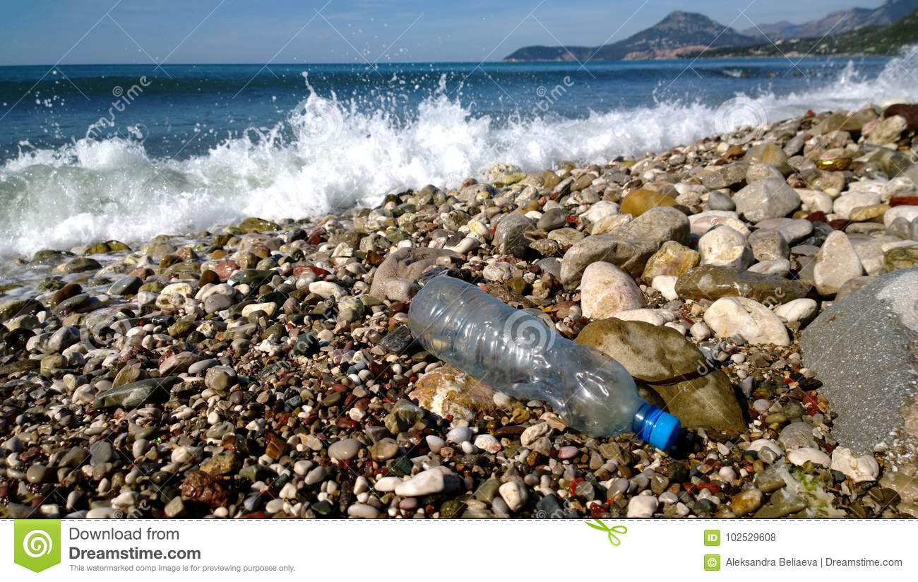 Download The Waves Of The Sea Washed Up An Empty Plastic Bottle. Environmental Pollution - Garbage In Scenic Spots Stock Photo - Image of hill, dirty: 102529608