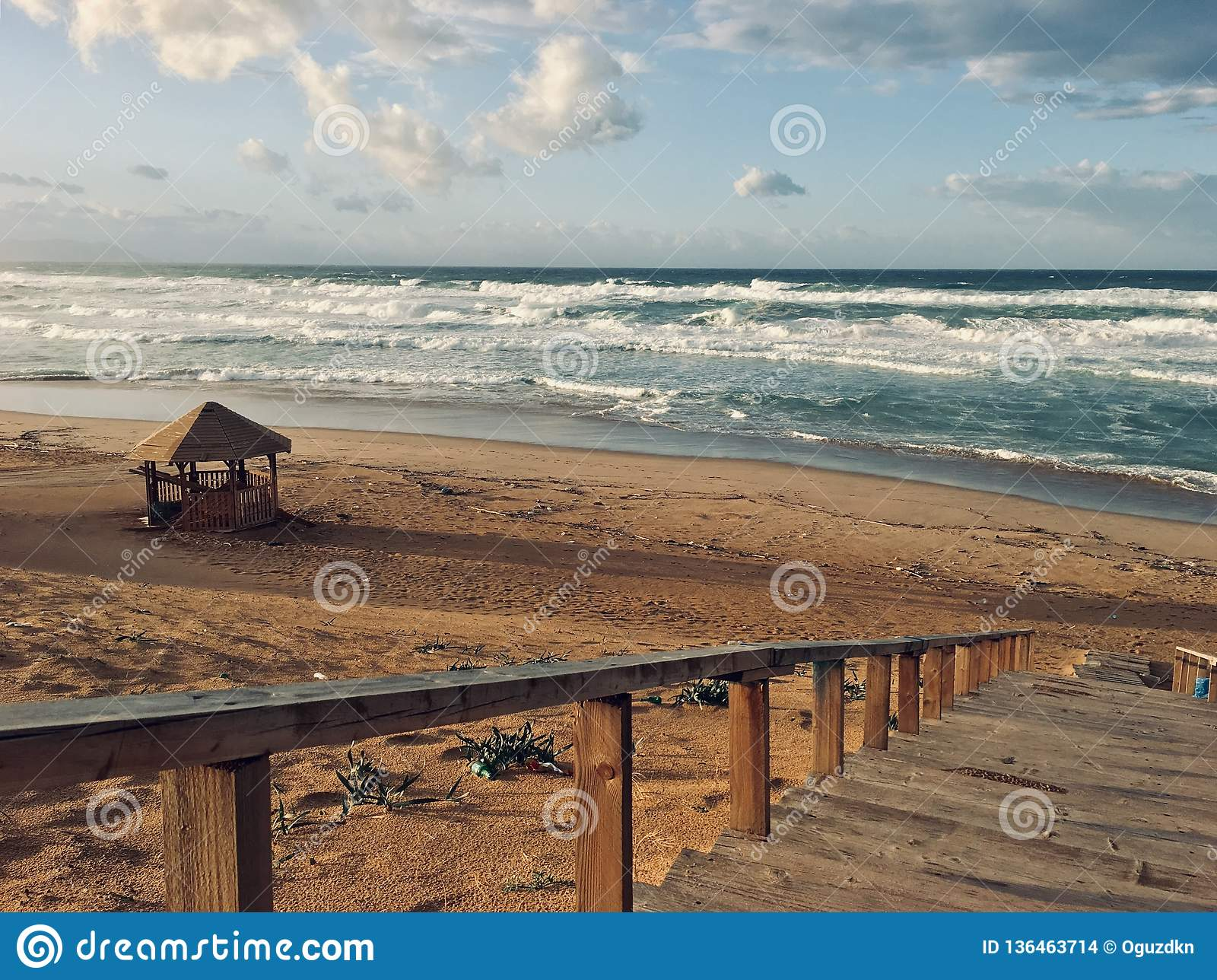 Wavy Mediterranean sea with stairs on sunset time in Skikda Algeria