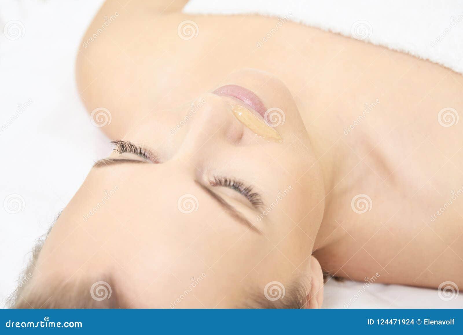 Waxing woman leg. Sugar hair removal. laser service epilation. Salon wax beautician procedure