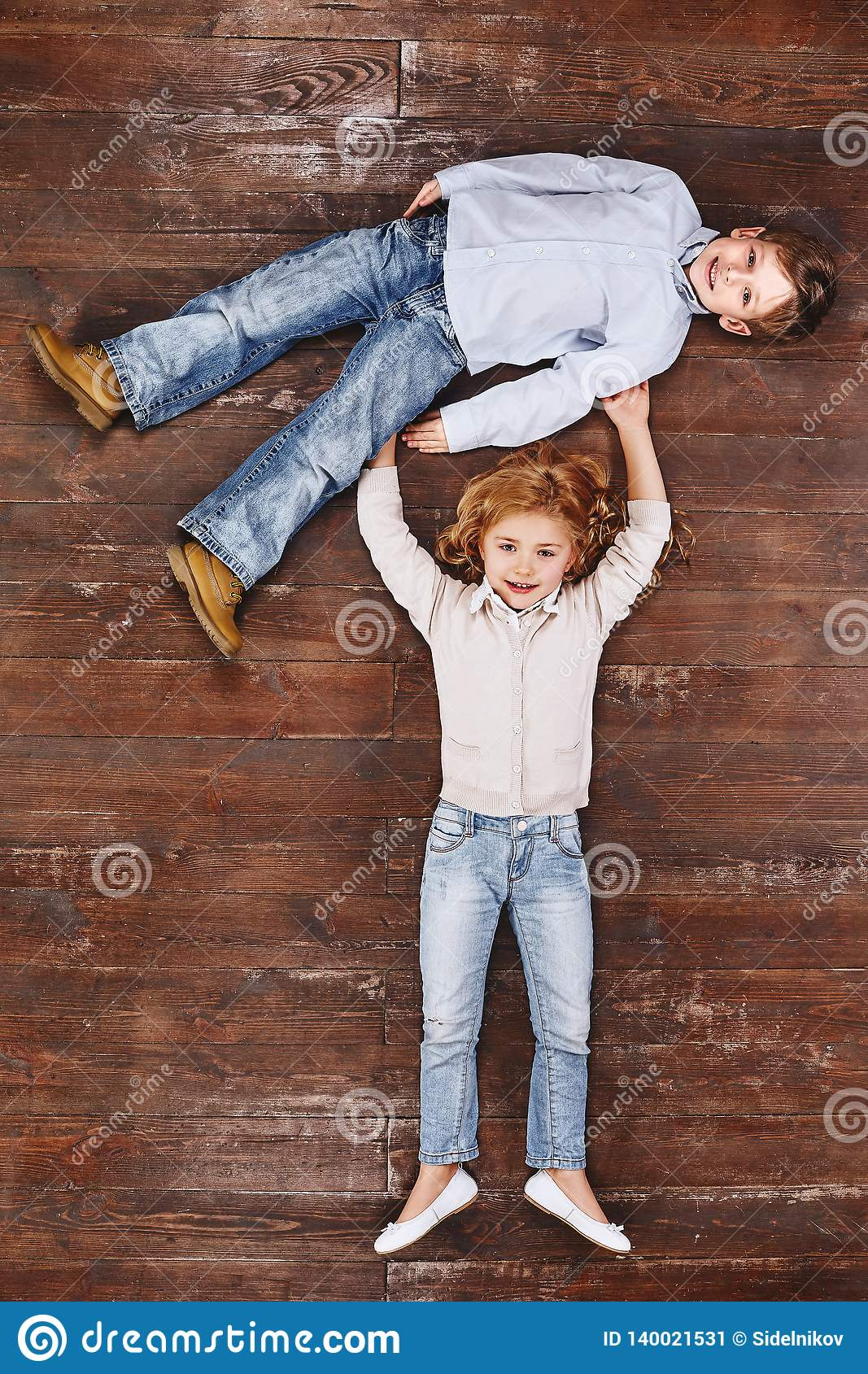 The only way to have a friend is to be one. Girl holding boy, looking at camera and smiling