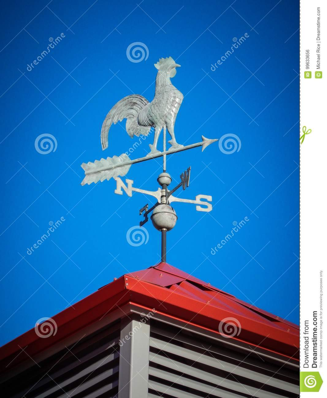Weather vane on red roof