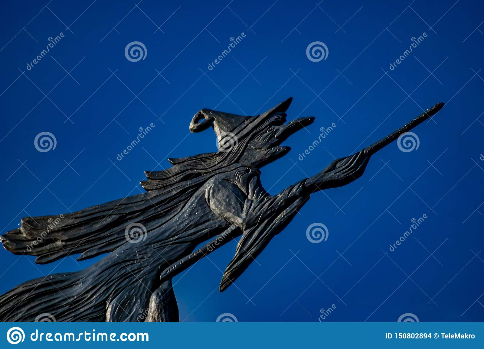 Weather vane of a witch flying on a broom