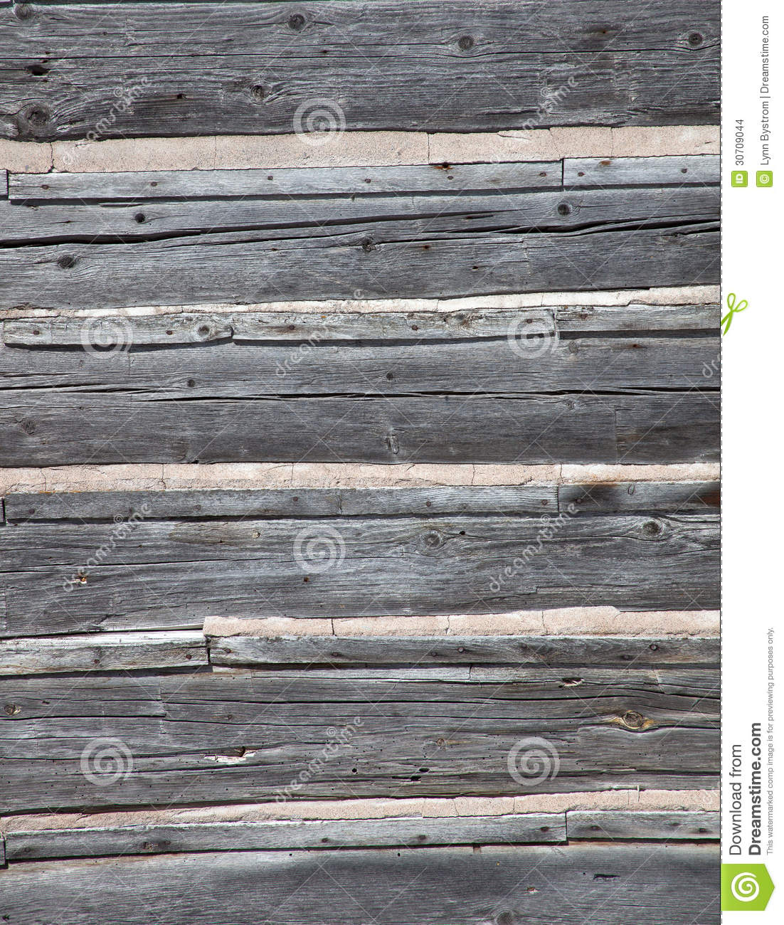 Weathered Barn Wood : Detail of old, weathered barn wood with chinking. Rough texture ...