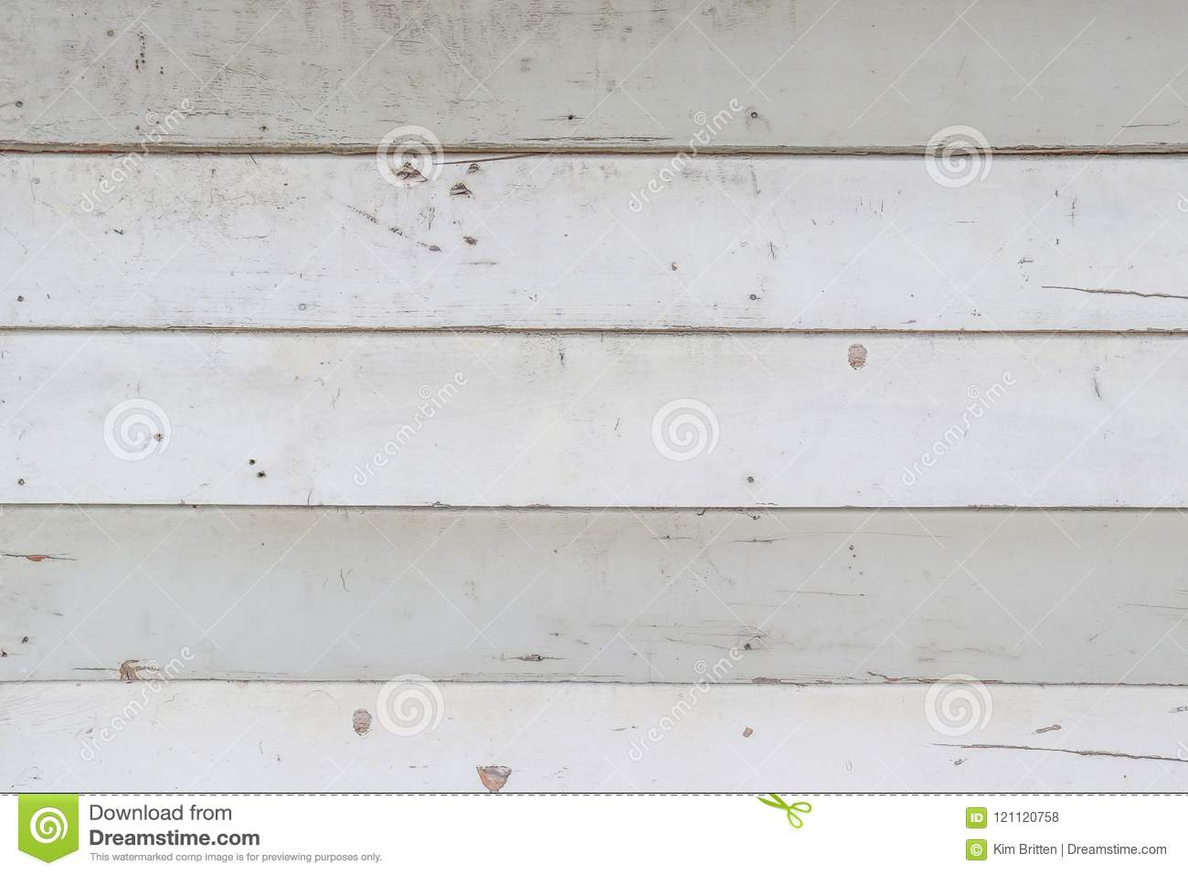 weathered and dirty white weatherboards on the exterior of a house