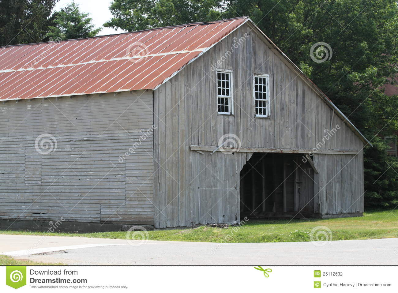 Weathered Grey Amish Barn With Red Metal Roof Royalty Free