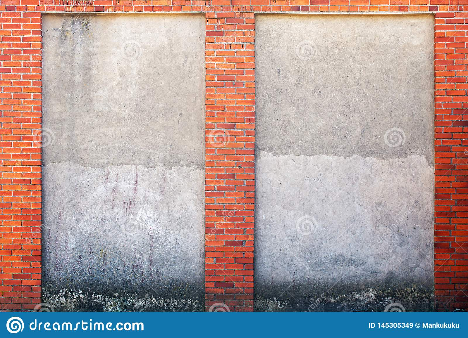 Weathered stucco wall and red brick frame around