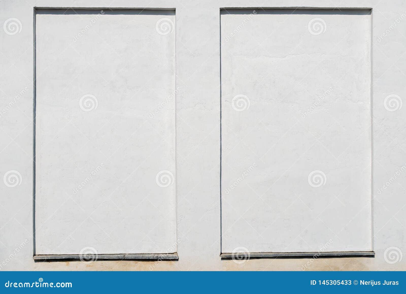 Weathered white stucco wall with a stucco frame