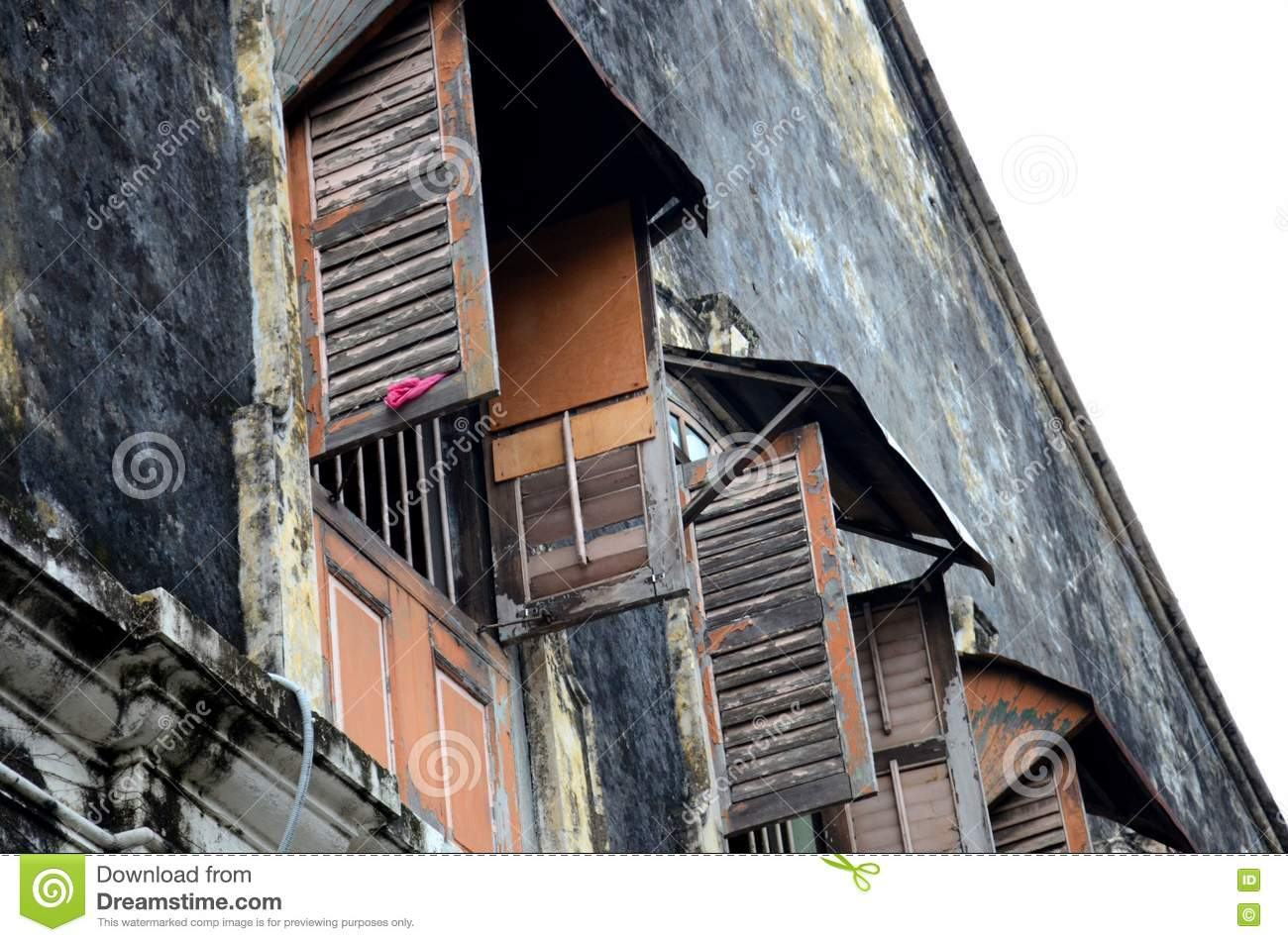 Weathered wooden shutters and windows in old building Georgetown Penang Malaysia