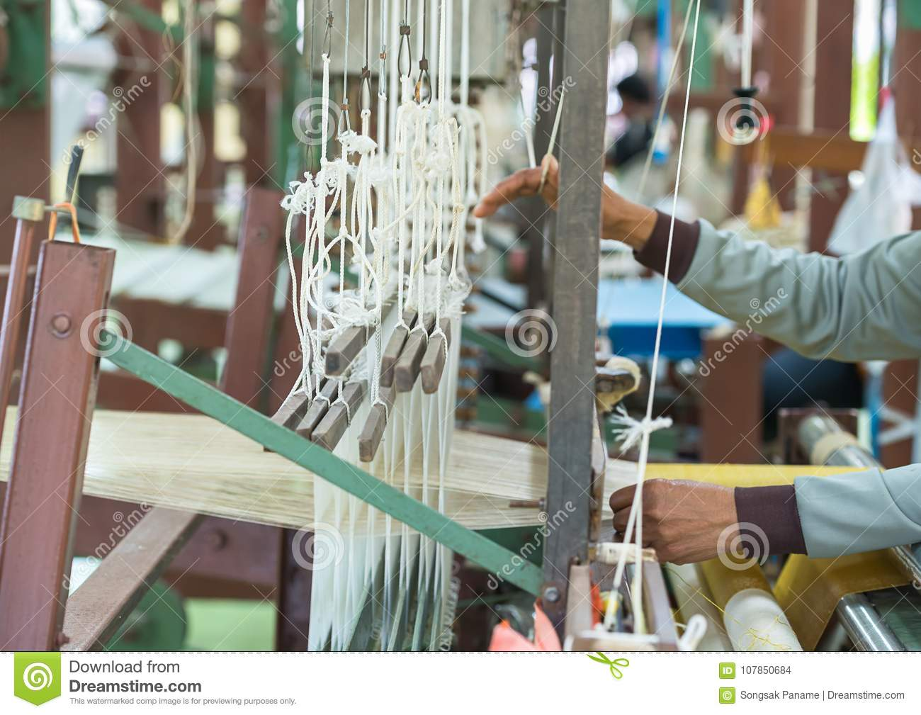 Weave Silk Cotton On The Manual Wood Loom Stock Photo