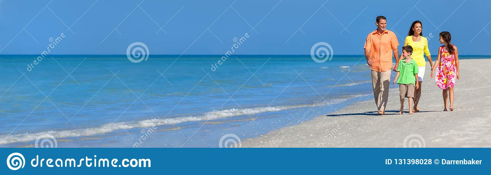 Web banner panoramic happy family of mother, father and two children, son and daughter, walking on a beach