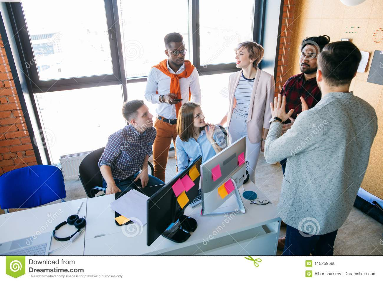 Web Designers Are Discussing Their Perspective Plans At Workplace Stock Photo Image Of Diverse Colleague 115259566