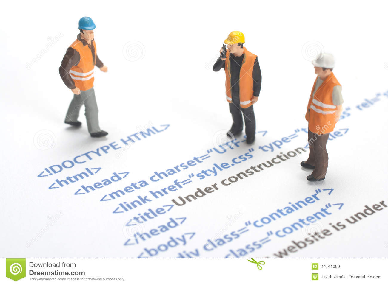 printed html code of website internet page under construction construction worker figurines working on code