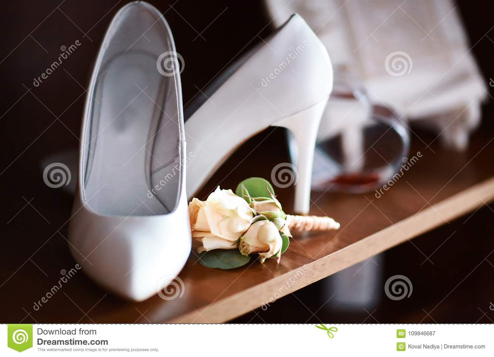 Wedding accessories bouquet beige flowers for groom and white shoes download wedding accessories bouquet beige flowers for groom and white shoes on heels dark wooden mightylinksfo