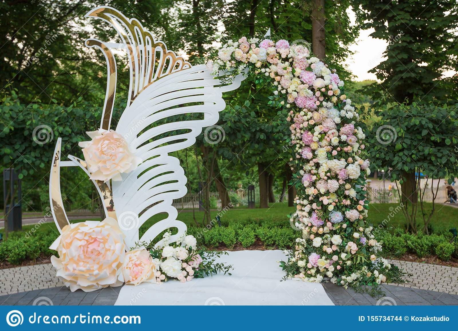 Wedding arch for ceremony outdoor with flower decoration