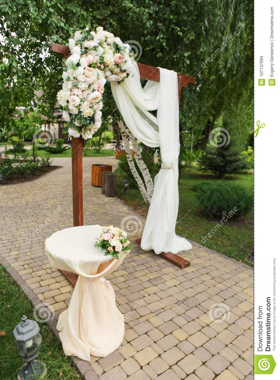 Wedding arch decorated with fresh flowers stock photo image of wedding arch decorated with fabric and fresh flowers junglespirit Choice Image