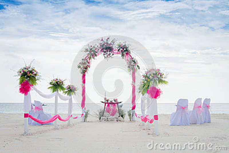 Wedding Arch Decorated With Flowers On Tropical Beach Outd Stock