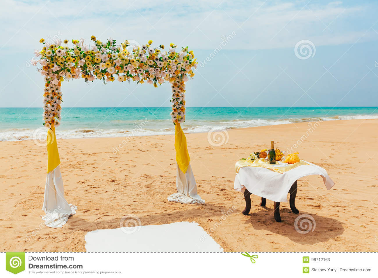 Outdoor Wedding Flower Ideas For A Beach Wedding: Wedding Arch Decorated With Flowers On A Tropical Sand