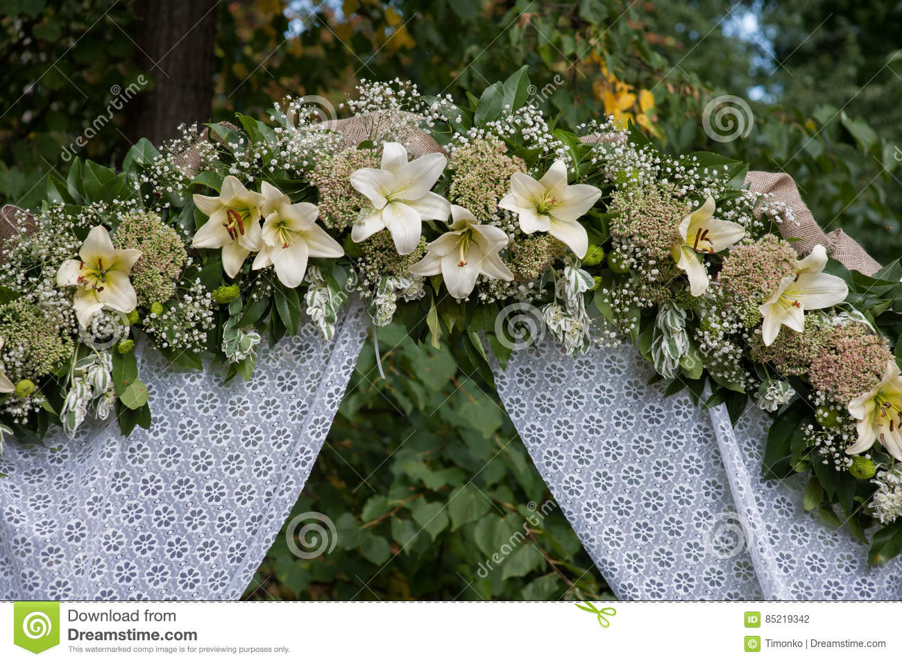 Wedding arch decorated with white flowers lilies stock photo image wedding arch decorated with white flowers lilies mightylinksfo