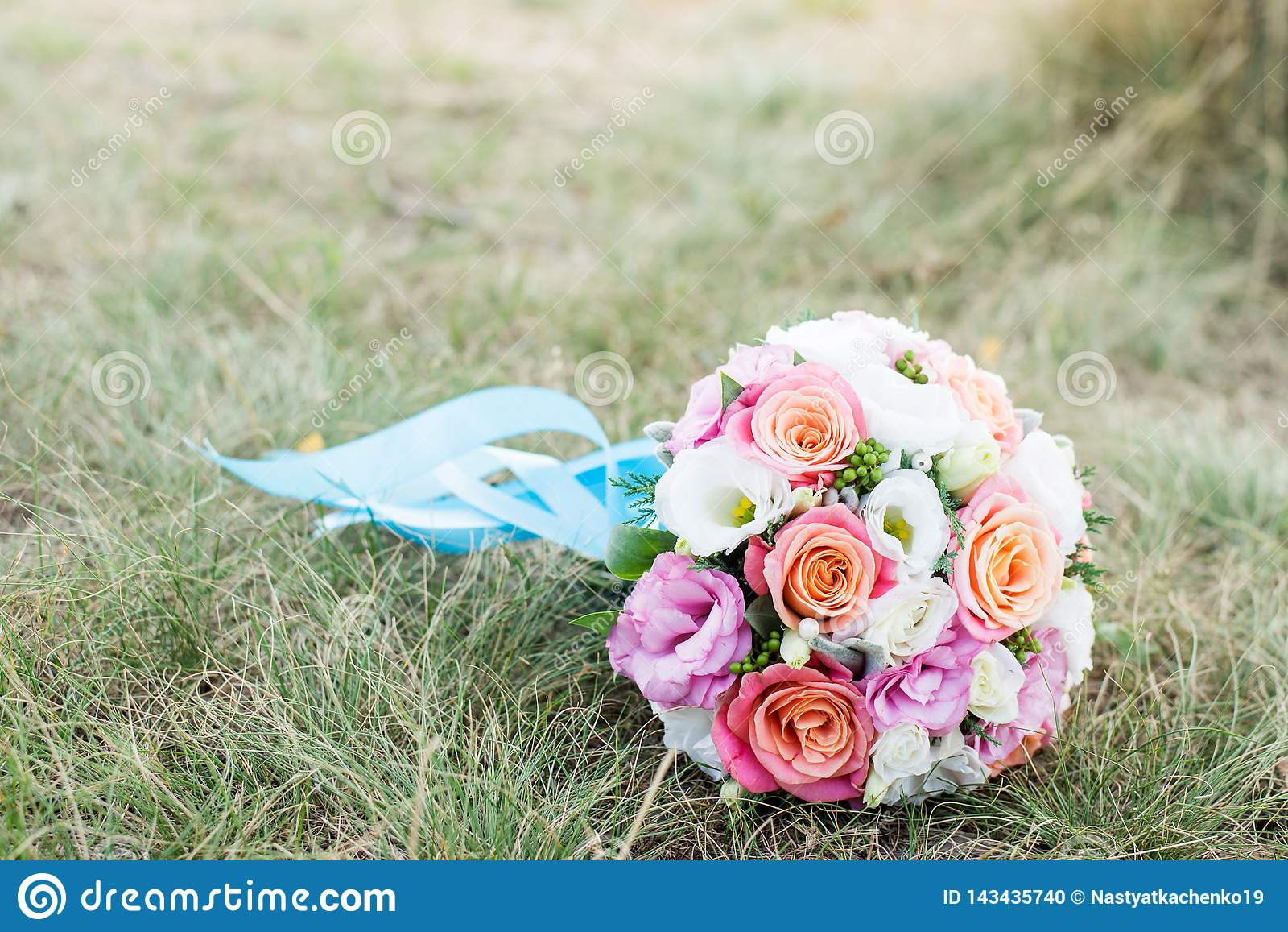 Wedding background. The bride`s bouquet with pink and white flowers on the grass. declaration of love. Wedding card, day details