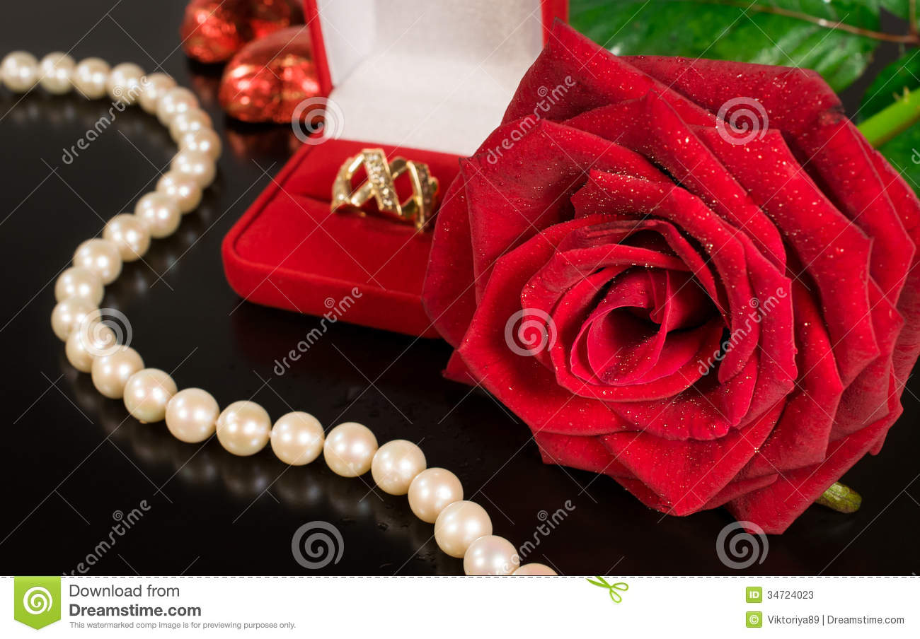 Wedding Background Rose Pearls And A Gold Ring Stock