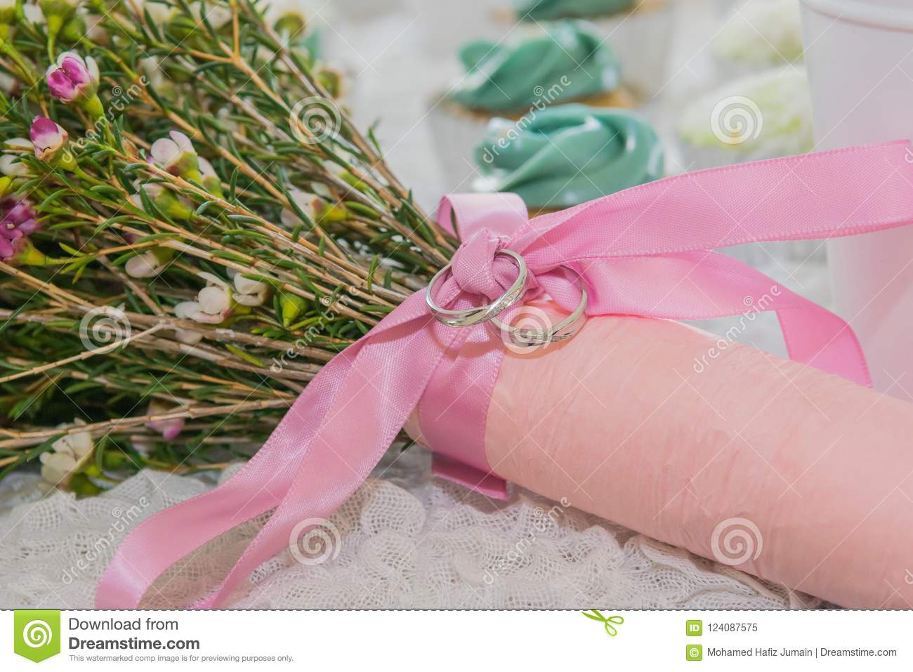 Wedding Band On Pink Ribbon Floral Bouquet Stock Image Image Of