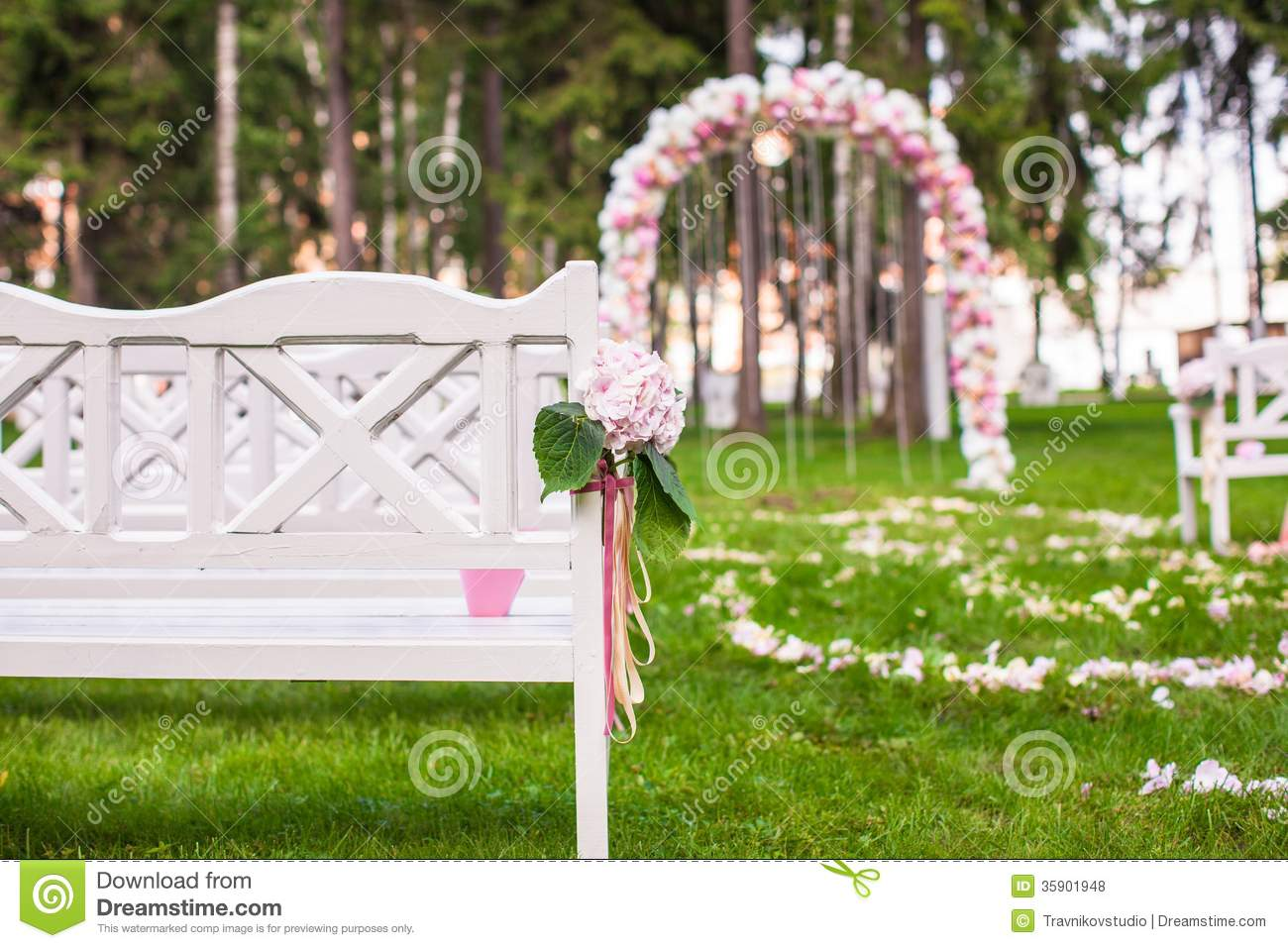 Wedding Benches And Flower Arch For Ceremony Stock Photo
