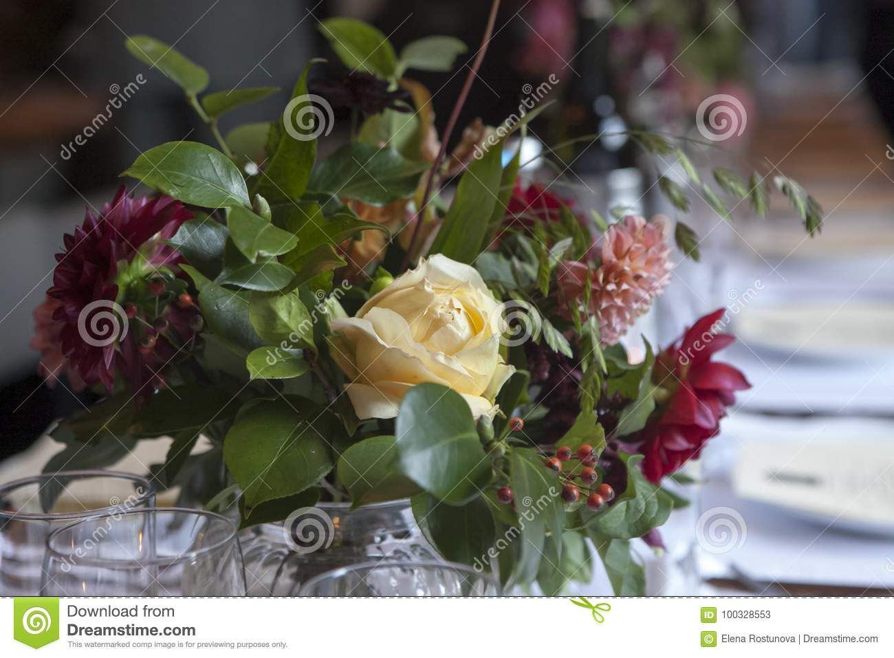 The Wedding Bouquet Of A Bride From Dahlias And Roses Decorates A