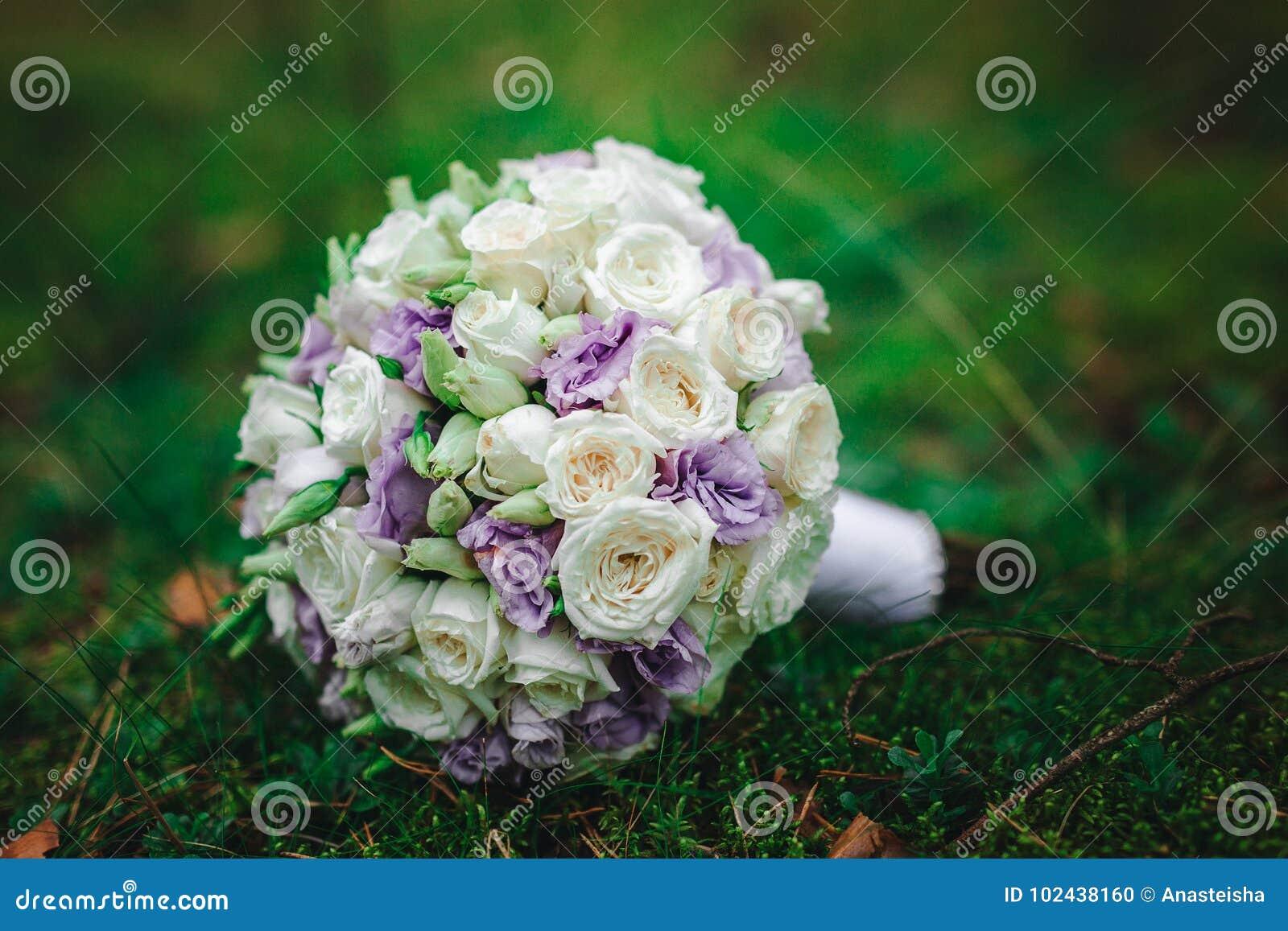 Wedding bouquet bride with purple flowers stock photo image of download wedding bouquet bride with purple flowers stock photo image of happiness decoration izmirmasajfo