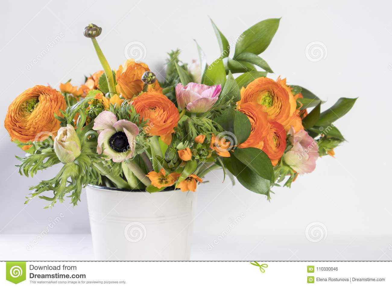 Wedding bouquet of buttercups anemones and ruscus stock photo a wedding bouquet of buttercups anemones and ruscus on the white background izmirmasajfo