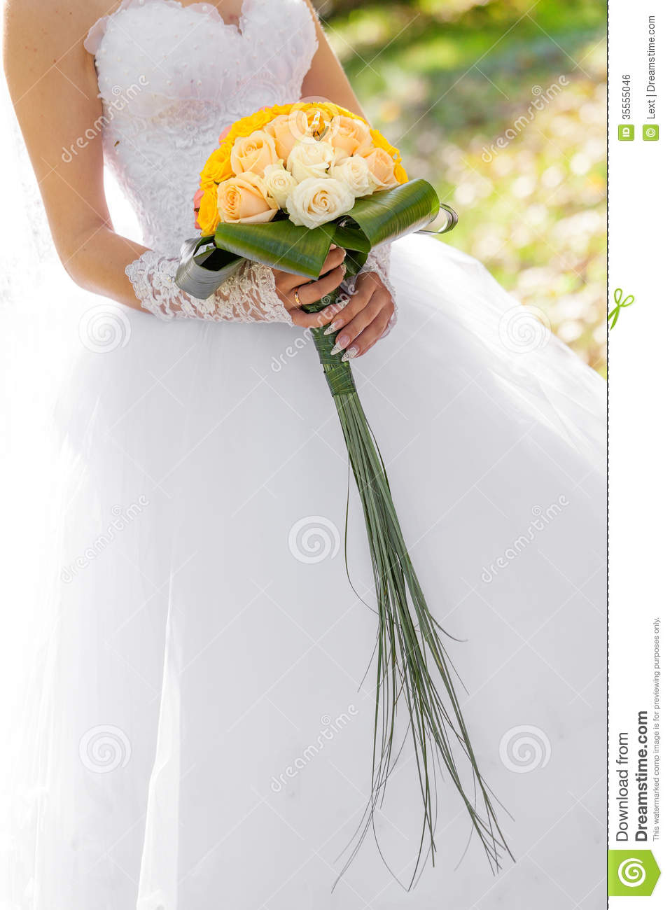 Wedding bouquet from flowers in hands of the bride stock photo royalty free stock photo izmirmasajfo